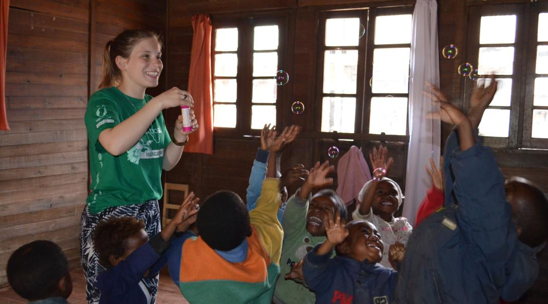 A volunteer is having fun with children in Madagascar after she fundraised her trip to this African country.